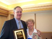 Peter Riffle with Patricia Lillie, president of the LDA of America